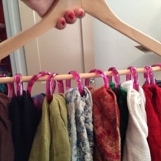 Using the shower hooks to hang the scarfs and put it on a hanger.. Definitely going to do that. :)