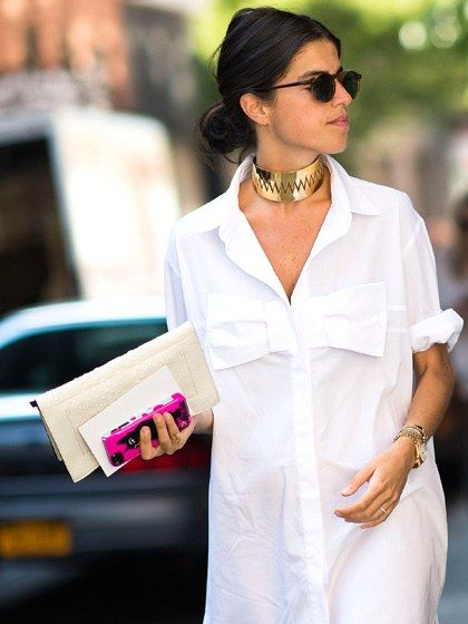 The best way to dress up a crisp white shirtdress is with glints of gold accessories and sky-high heels à la Leandra Medine.