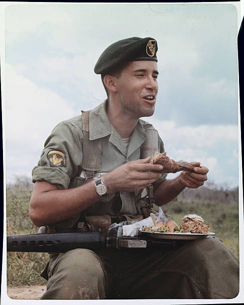 November 16, 1966 - Army trooper enjoys an early Thanksgiving dinner in the field.