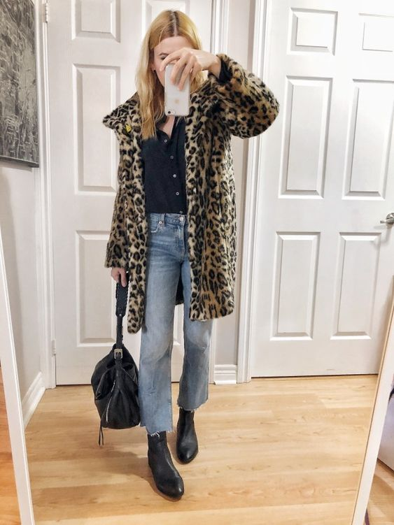 What I Wore. I am wearing a black silk blouse, cropped jeans, animal print jacket, and a black boots.
