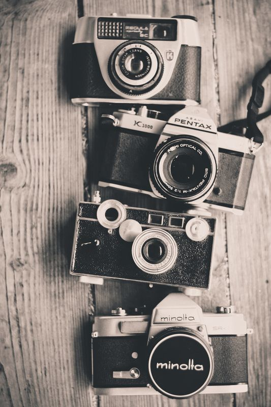 I love this picture, the way it is in black and white, and the way the wood sets off the cameras! Love it xoxo