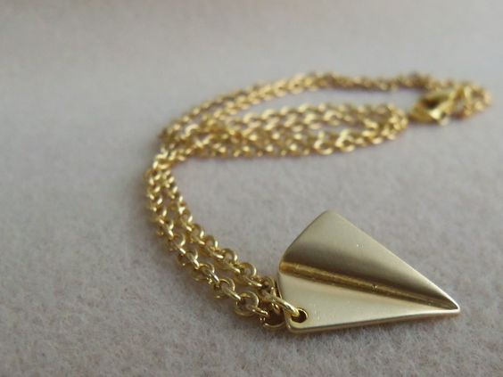 Hello all Directioners! This attractive gold-toned paper airplane necklace is like the silver one worn by Harry Styles! The necklace measures in 47.5 centimeters or 18 1/2 inches. If you, yourself, are dedicated to this amaZayn band, you've come to the right place! It's never too early to think about presents for your best friends, fellow Directioners, or girlfriends!