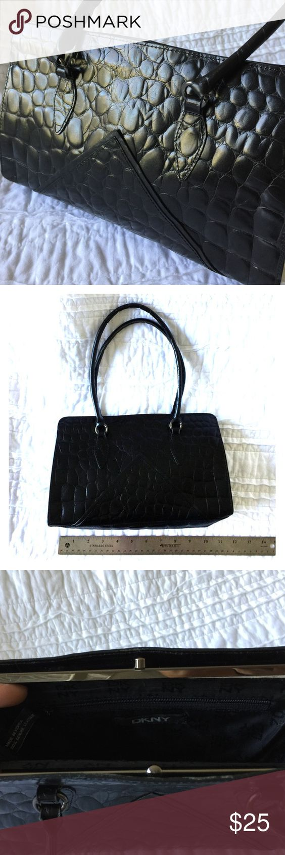 """DKNY Leather small shoulder bag This is a super chic bag but it needs a repair to the clasp. See picture. Black leather. Small zipper pocket inside. Goes with everything. 11"""" long, 7"""" high, 3"""" deep. DKNY Bags Shoulder Bags"""
