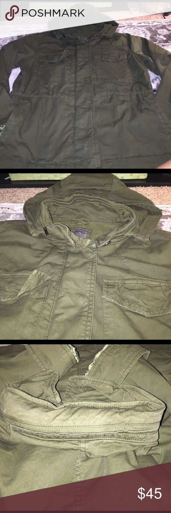 Worn once GAP green utility jacketw/hidden hood Sold out first shipment- army green, fits to your waist and true to size. No defects. Worn once. Size medium women. Not from outlet!!!!  Authentic gap store- 2014. Sinched waist/ shell--97% cotton/ 3% spandex / body lining-- 100% cotton / sleeve lining-- 100% polyester. GAP Jackets & Coats Utility Jackets