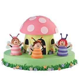 Spritely Celebration Cake. Fondant features and licorice appendages animate fairy figures formed in our Brownie Pops 8-Cavity Silicone Mold. Fashion an equally fanciful fungus abode using a Dimensions® Giant Cupcake Pan cake and fondant details.