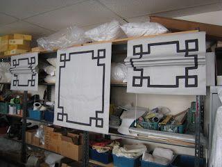 Workroom view of greek key tape trim on roman shades.  #windowtreatments #romanshades