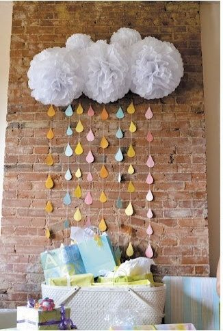 Such a cute idea for decor at a baby shower! Tissue paper poms with scrapbook paper rain  Get supplies at Flower Factory www.flowerfactory.com