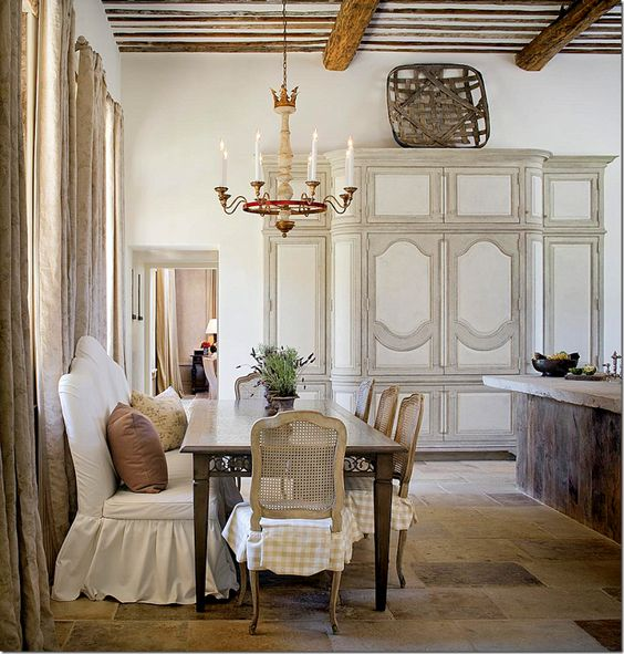 This French Country dining room with its slipcovers and rustic elegance is a glorious balance of humility and decadence. See more #FrenchCountry in the full story.