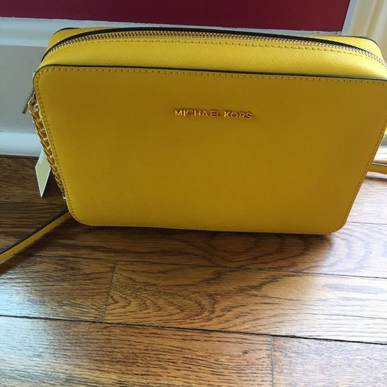 Yellow Michael Kors crossbody bag Brand new with tags still attached. Yellow crossbody bag Michael Kors Bags Crossbody Bags