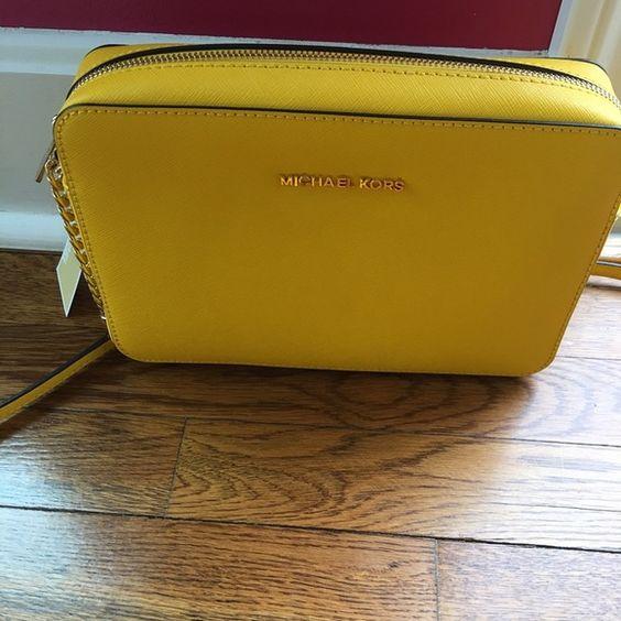 Yellow Michael Kors crossbody bag Brand new with tags still attached. Yellow crossbody bag Michael Kors Bags Crossbody Bags