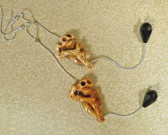 Shoulder dusting climbing skeletons earrings?!?  Why don't I have these?