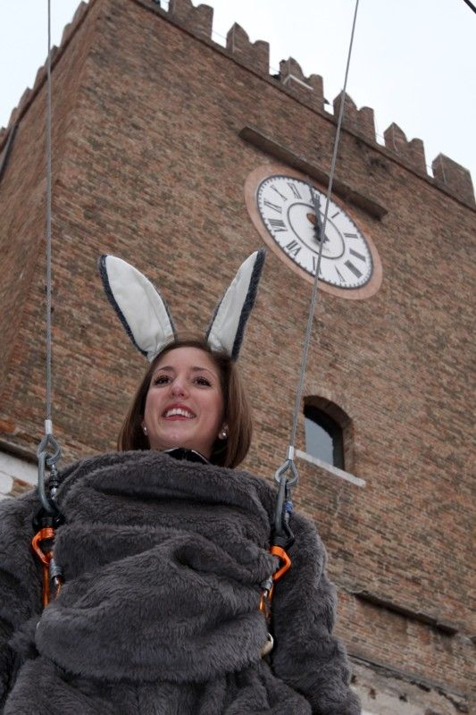 """""""The Donkey's Flight (Volo dell'Asino) is Mestre's response to the more known Volo dell'Angelo (Angel's Flight) that opens every year the Carnival period in Venice. It's a festive event and a grotesque parody of its more famous """"cousin"""" that pokes fun at it animating the small Ferretto Square."""":"""