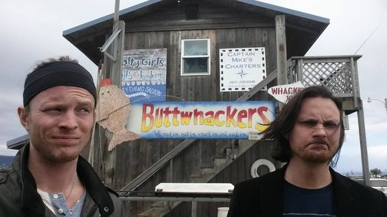 Austin and Tim in Alaska, in front of some very interesting signs. LOL.