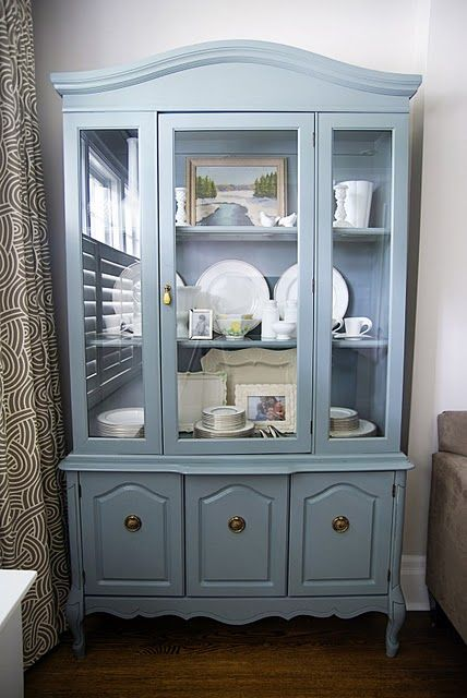 Such a pretty way to display white china dishes, I like the way they look against the slate blue.