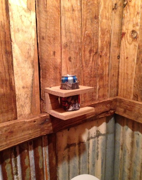 My husband says a drink holder is necessary for the man cave bathroom!