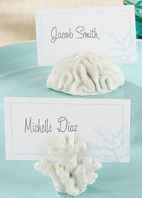 """The most intriguing sea-floor decor now decorates more! Create a deep-sea dream of a tabletop with these clusters of coral at your special event, bringing with it an ocean of thanks to every guest.  Features and Facts:  Remarkably detailed, resin clusters of coral with slot for place card or photo  Sold in a set of six includes two clusters of coral each in three distinct designs  Aqua-accented, coral-themed place cards included  Largest of the three designs measures 1 1/4"""" h x 2"""" w"""