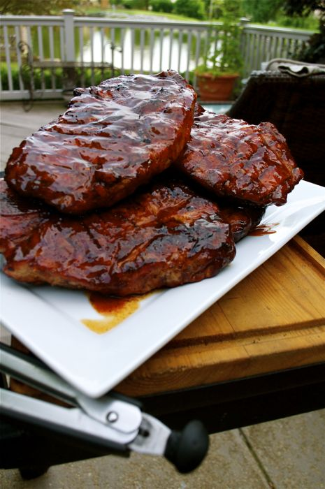 An explanation of what exactly a pork steak is as well as how to perfectly prepare them on the grill, slathering them with a gooey BBQ sauce. | A Midwestern BBQ Staple – Pork Steaks | http://grillinfools.com