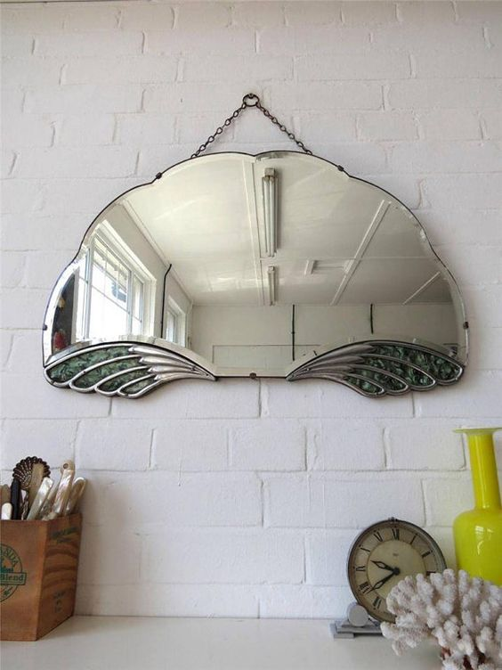 Lovely original Art Deco wall mirror with unique fan shape and chrome Pegasus wings . Would look great in Contemporary setting.  PS! If you are on the