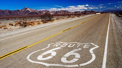Route 66 sign on highway near Amboy.