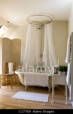freestanding roll top bath with circular shower curtain in ac011 27 freestanding roll top bath below shower cano