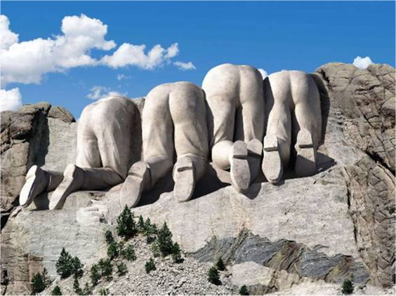 Mt. Rushmore from the Canadian side... (my favorite thing EVER).  These look like our assholes in Washington to me!