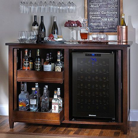 Firenze Mezzo Wine and Sprits Credenza with 28 Bottle Touchscreen Wine Refrigerator This distinctive wine and spirits bar with refrigerator will enhance any interior with its handsome good looks and versatile style. Features:  Rich espresso finish Wine refrigerator holds 28 standard size bottles Digital touchscreen temperature control Dimensions:  37 H X 53 1/2 W X 24 7/8 D Inches