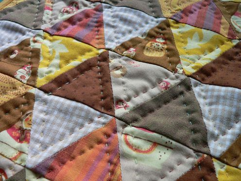 Hand quilted matryoska, equilateral triangles.  Did I mention the matryoshkas?