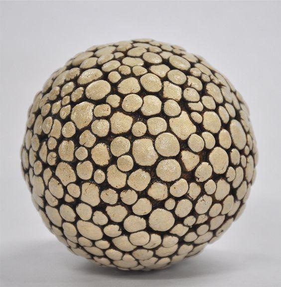 Polka Dot Ceramic Ball Rattle by Kelly Jean Ohl. This is a hand carved ceramic ball rattle.: