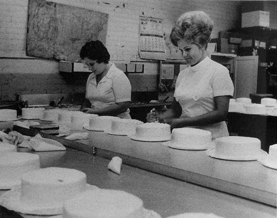 Bakers hand-decorate cakes at the main plant of Hough Bakery (best cakes EVER). 1973, Cleveland.