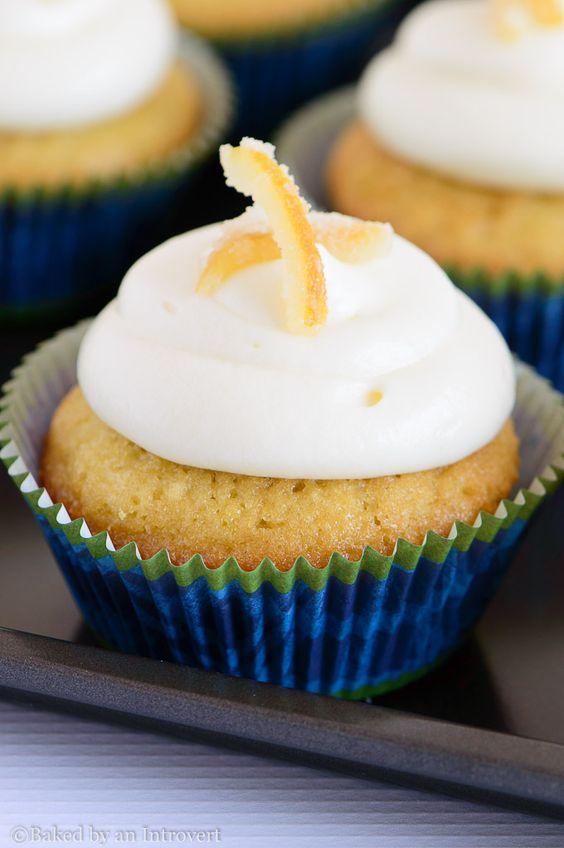 Vanilla Cupcakes with Lemon Cream Cheese Frosting - Homemade vanilla cupcakes topped with a sunshine sweet lemon cream cheese frosting. So full of bright spring flavors!