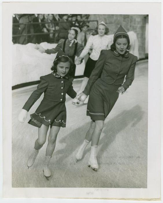 Woman and girl skating together