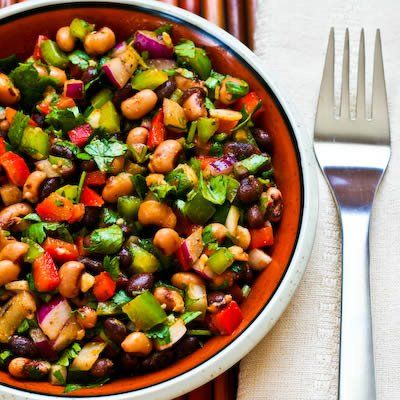 Bean Salad...AMAZING!  1 can Black Eyed Peas  1 can Black Beans  1 can Shoe Peg Corn  3 each MINI Sweet Peppers-Yellow, Orange, Red  Chopped Handful of Cilantro  Bunch of Greens Onions  Bottle of Zesty Fat Free Italian Dressing.  Drain beans,peas and corn. Dump in bowl. Add all other ingredients. Marinate over night or at least 6 hours. Strain. Serve with chips or as a side dish or filling for tacos.