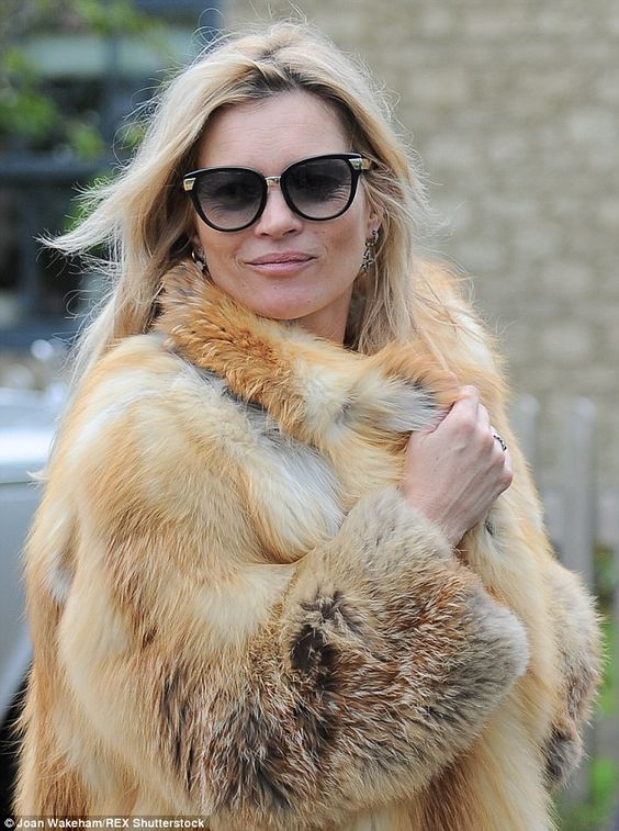 Foxy lady: The supermodel wrapped up in a fox fur coat as she enjoyed near her 10-bedroom ...: