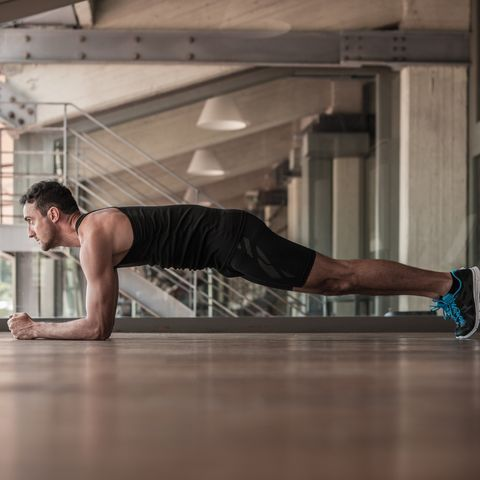 Mid adult man doing plank exercise