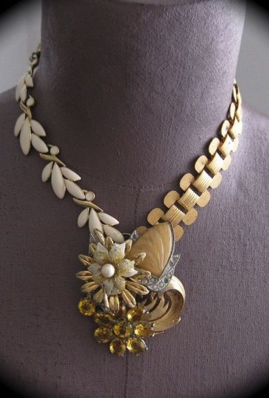 Love these asymmetrical necklaces made with vintage jewelry.