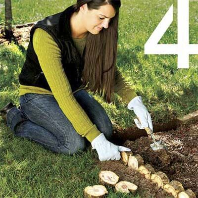 Cut the trunk of your Christmas tree into discs to edge flower beds or walkways! See 9 more reuse ideas for your Christmas tree! (Photo: Kolin Smith): Garden Ideas, Tree Trunks, Tree Trunk Ideas, Christmas Trees