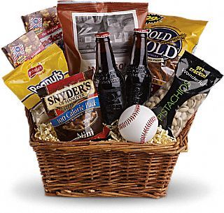 """Buy me some peanuts and Cracker Jacks – and throw in some pistachios, peanuts, pretzels and root beer while you're at it! What a fun summer gift basket or Father's Day present.  This baseball-themed basket includes three bags of pretzels, a bag of pistachios, two boxes of Cracker Jacks, a bag of peanuts, two bottles of root beer and a baseball.  Approximately 16 1/2"""" W x 14 3/4"""" H.  Standard:  T108-1A  Deluxe:  T108-1B  Premium:  T108-1C"""