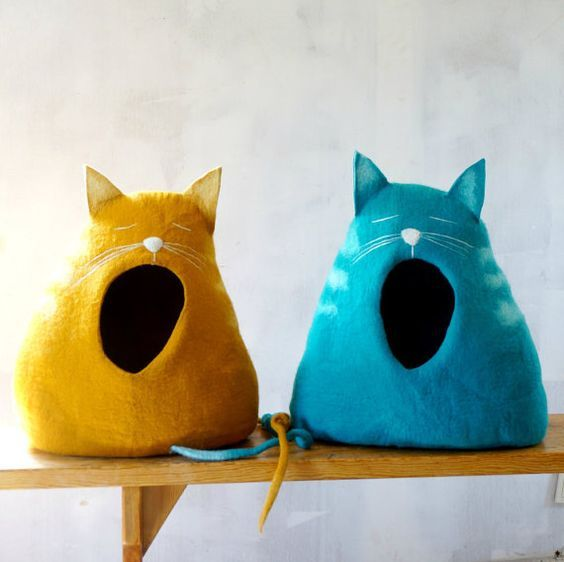You can't help but smile when you see these felted cat caves. Shaped like yawing cats these cat beds are some of the most creative cat stuff or pet stuff we've ever seen.: