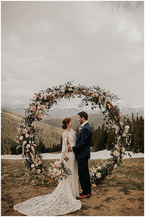 Colorado mountain top wedding. Boho mountain wedding. Circle arch alter. www.josieengland.com