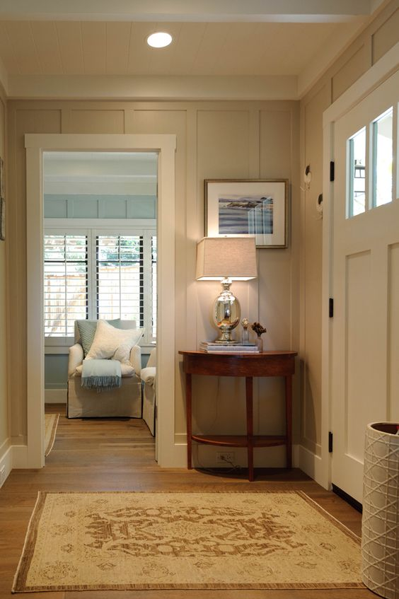 entryway with floor to ceiling board n batten - creamy color with blue room next - just like we want to do in br house