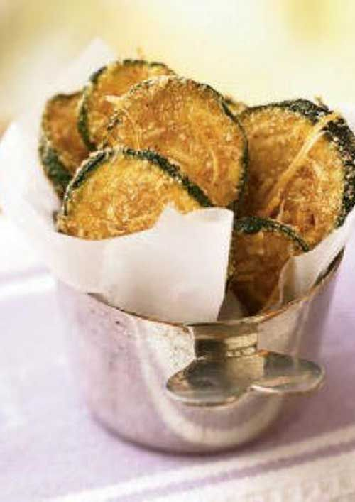 Recipe for Zucchini Oven Chips - Breaded, oven-fried zucchini chips taste like they're fried, yet they are baked and amazingly crispy. These chips make a healthy substitute for French fries or potato chips.