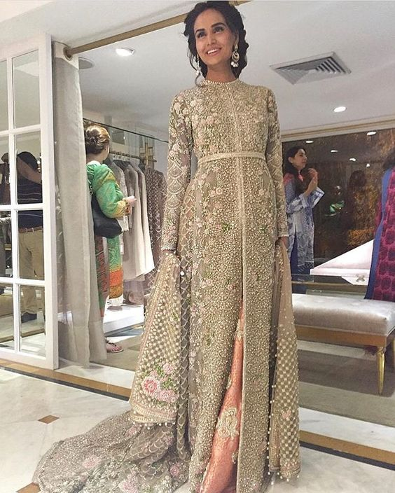 Mehreen Syed in Faraz Manan | white heavily embroidered maxi bridal dress with peach lehenga | walima or nikah dress | Pakistani wedding fashion
