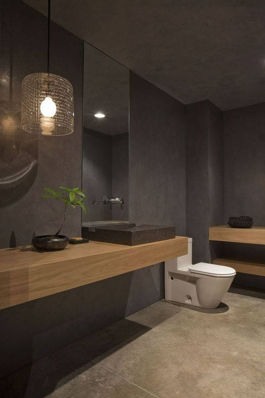 grey bathroom with mid toned wood wall hung wooden vanity shelfconsole modern sanitary ware toilet