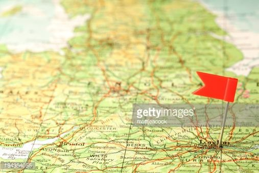 Stock Photo : Red flag pin in a map