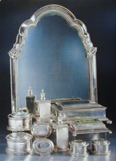 silver toilet set comprising table mirror,  casket, boxes and brushes.  London 1699