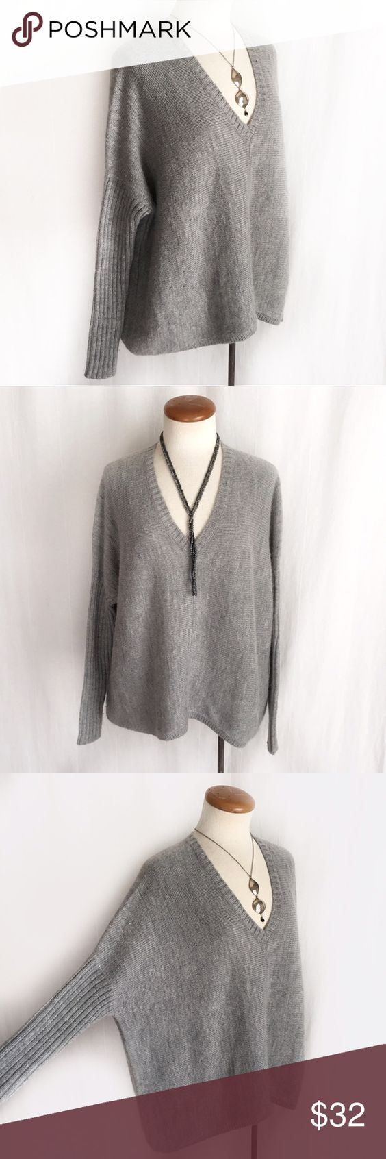 "Kenar Gray Oversized Sweater Oversized V-neck wool blend sweater with dolman/batwing style long sleeves. Light gray. 70% acrylic; 15% alpaca; 15% wool. Size Petite Small. Bust: 27"" flat across. Length: 24"". Very light wear. EUC. Thanks for looking! Kenar Sweaters V-Necks"