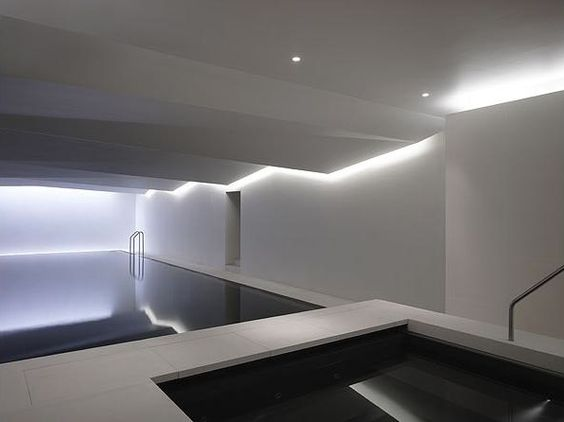 indoor swimming pool lighting. grey walls and recessed lighting give this indoor pool a minimalist appeal pools swimming m