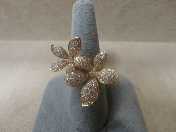 Yellow gold and diamond flower ring. Available at www.yanina-co.com, 800-780-3433.