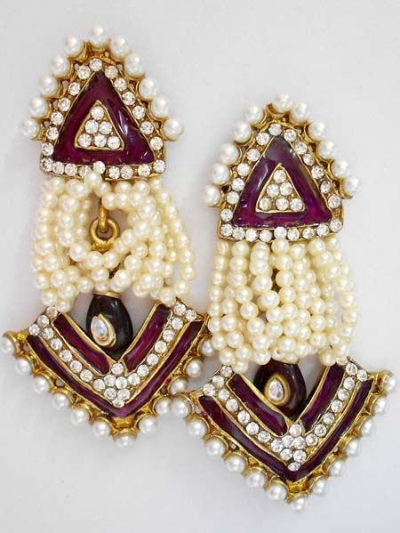The very latest and exclusive pair of stone studded earrings, crafted and desinged beautifully with high quality AD and CZ stones.