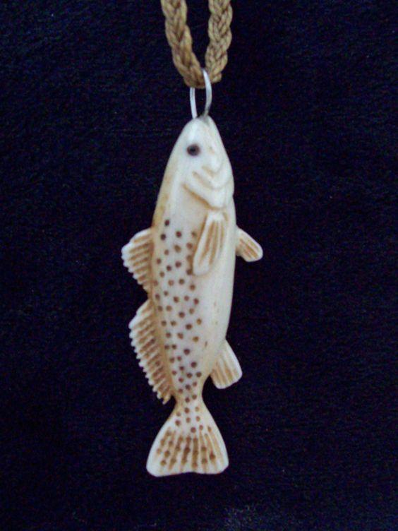 Carved bone speckled trout pendant carving